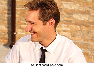 Satisfied smiling businessman, near house, outdoors