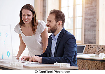 Satisfied two colleagues checking accounts