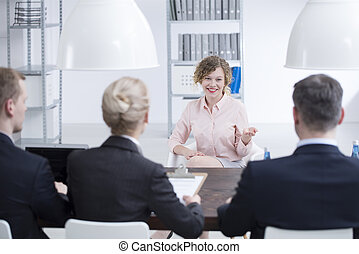Satisfied woman during recruitment interview