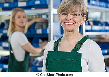 Satisfied woman in the factory - Female blue-collar worker ...