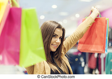 Satisfied woman with shopping bags