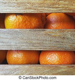 Satsumas in a wooden crate