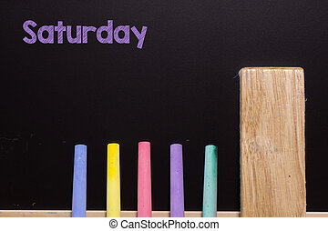 Saturday on Blackboard with chalk and eraser