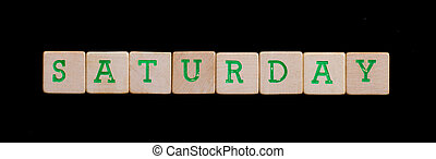 Saturday spelled out in old wooden blocks