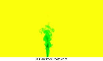 Satureted green smoke on yellow isolated