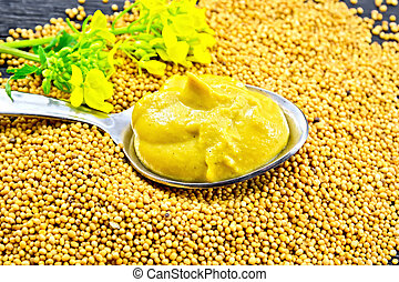 Sauce mustard in spoon with flower on seeds - Mustard sauce ...