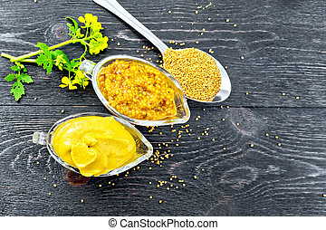 Sauce mustard in two sauceboats with flower on board top