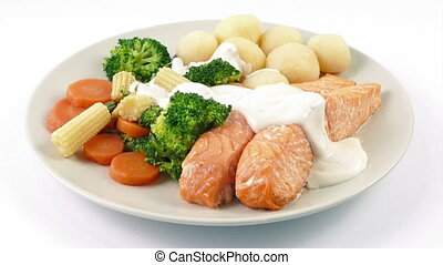 Sauce Poured On Meal Of Salmon, Potatoes And Vegetables -...