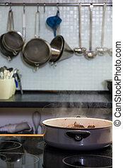 Saucepan on the plate