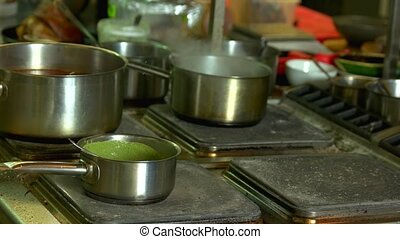 Saucepan with green soup. Vegetable puree preparation.
