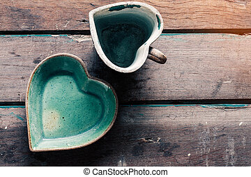 Saucer and cup on wooden floor.