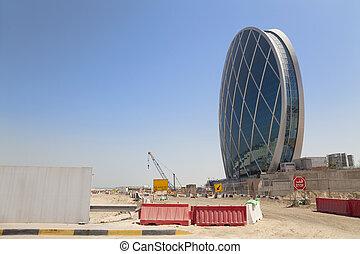 Image of a unique saucer shaped building under construction at Abu Dhabi, United Arab Emirates. One of the many beautiful buildings being constructed in this fast growing country.