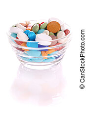 Saucer with many-colored pills - Transparent saucer with...