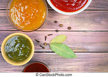 sauces on a wooden background