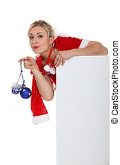 Saucy Miss Santa with baubles and a board left blank for your message