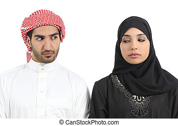 Saudi arab couple angry with problems isolated on a white...