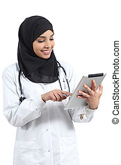 Saudi arab doctor woman working with a tablet