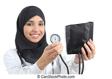 Saudi arab woman showing a sphygmomanometer