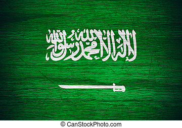 Saudi Arabia flag or banner on wooden texture
