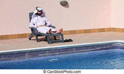 Saudi arabian at swimming pool
