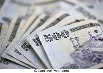 Saudi notes lined up in a circular way - Saudi Riyal is the...