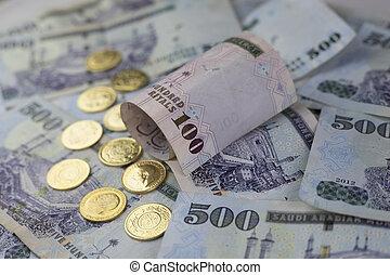 Saudi Riyal notes with Golden coins - Saudi Riyal is the...