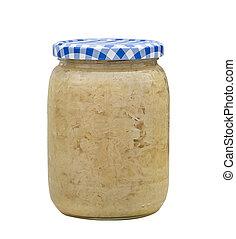 Sauerkraut in a glass jar on white background