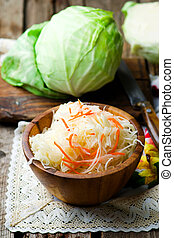 sauerkraut in a wooden bowl