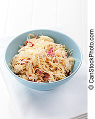 Sauerkraut - pickled cabbage in the bowl with onion