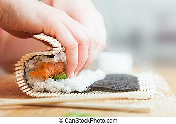 saumon, sushi., bois, riz, préparer, avocat, table., baguettes, rouler