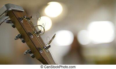Saundboard of acoustic guitar - instrument on stage