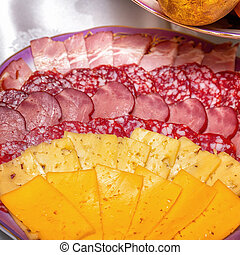 Sausage and cheese sliced on plate