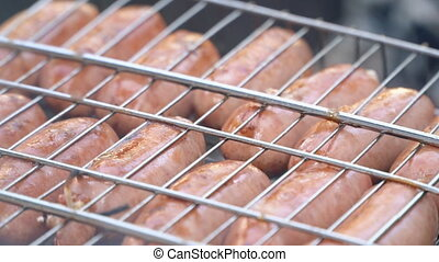 sausage cooking on fire close-up