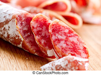 Sausage. Dried Smoked Sausages Sliced on Board