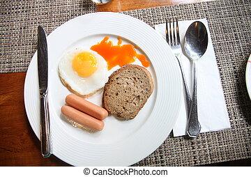 Sausage egg bread in white dish.