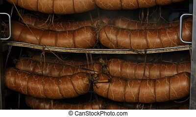 sausage is hot in the oven cools soars smokes cook sausage beef pork chicken meat plant for the production of sausage products high temperature