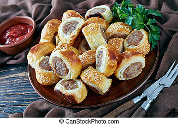 sausage rolls on a plate, close up