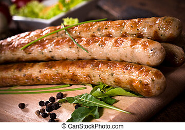 Sausage time - Close p to grilled sausages on wooden...