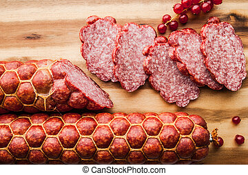 Sausage with  current  on the wooden board