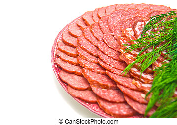 sausage with herbs on plate. close-up