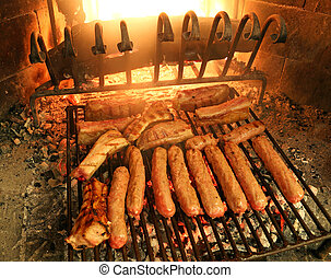 sausages and beef steaks cooked on the grill of a fireplace