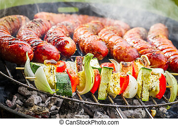 Sausages and skewers on the grill
