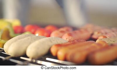 Sausages and vegetables on grill.