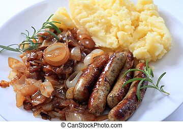 Sausages fried onions and potato