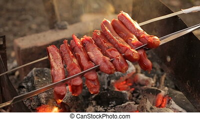 Sausages on coals in the campaign