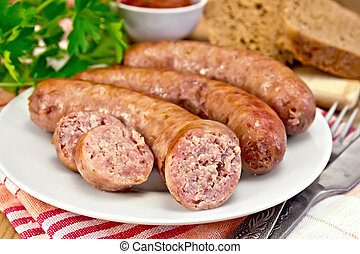 Sausages pork fried in plate on board with parsley