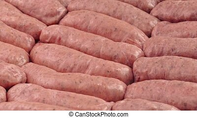 Sausages Rotating Slowly