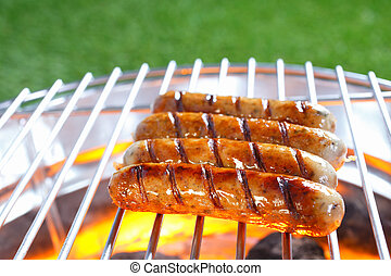 Sausages sizzling on a hot barbecue - Row of beef and pork ...