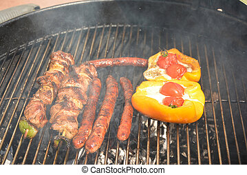 Sausages,meat and pepper on the barbecue grill