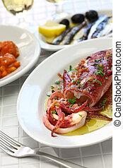 sauteed calamari with parsley and garlic, spanish tapas food